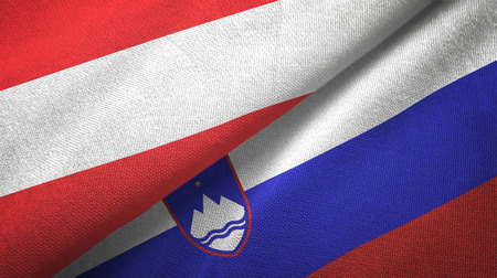 Austria and Slovenia flags together textile cloth, fabric texture Stock Photo