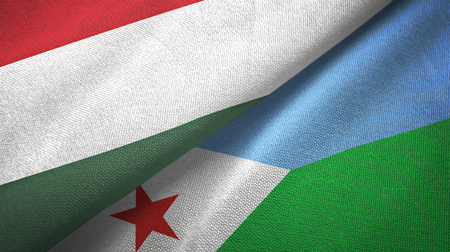 Hungary and Djibouti two folded flags together Foto de archivo