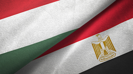 Hungary and Egypt flags together textile cloth, fabric texture. Text on egyptian flag means - Arab Republic of Egypt Foto de archivo