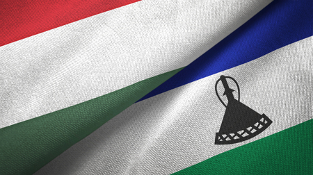 Hungary and Lesotho two folded flags together