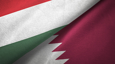 Hungary and Qatar flags together textile cloth, fabric texture Foto de archivo