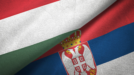 Hungary and Serbia flags together textile cloth, fabric texture