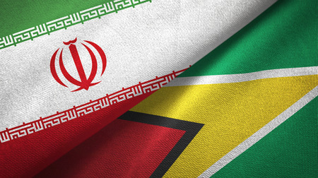 Iran and Guyana two folded flags together Stock Photo