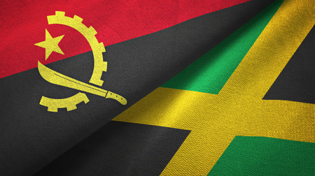 Angola and Jamaica flags together textile cloth, fabric texture Stock Photo