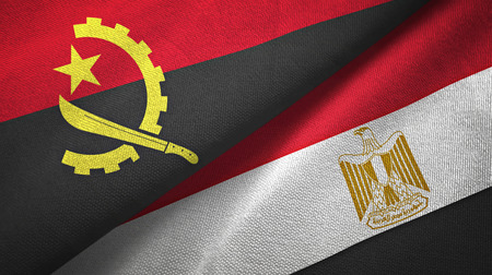 Angola and Egypt flags together textile cloth, fabric texture. Text on egyptian flag means - Arab Republic of Egypt Stockfoto