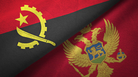 Angola and Montenegro flags together textile cloth, fabric texture Stock Photo