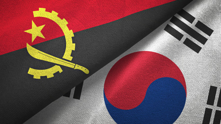 Angola and South Korea flags together textile cloth, fabric texture Stock Photo