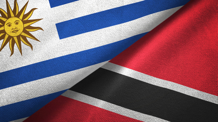 Uruguay and Trinidad and Tobago two folded flags together Stock Photo