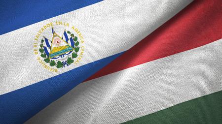 El Salvador and Hungary flags together textile cloth, fabric texture Foto de archivo