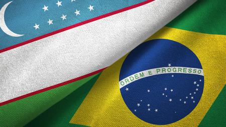 Uzbekistan and Brazil flags together textile cloth, fabric texture Stock Photo