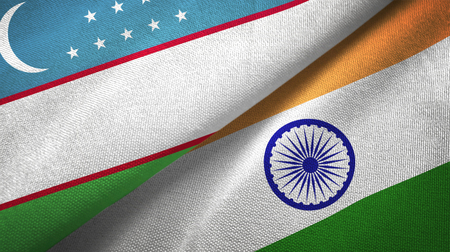 Uzbekistan and India flags together textile cloth, fabric texture