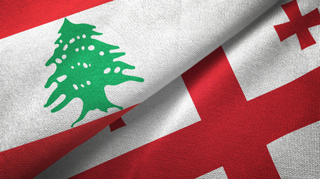 Lebanon and Georgia flags together textile cloth, fabric texture