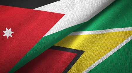 Jordan and Guyana two folded flags together