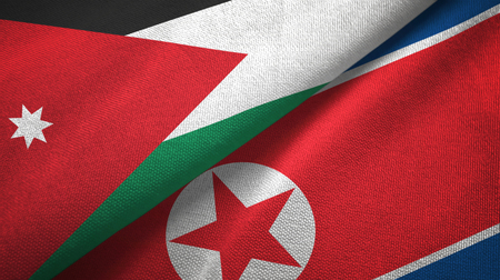 Jordan and North Korea two folded flags together