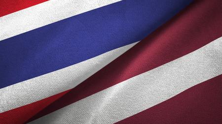 Thailand and Latvia flags together textile cloth, fabric texture Stok Fotoğraf