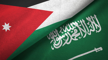Jordan and Saudi Arabia flags textile cloth, fabric texture. Text on saudi arabian flag means - There is no god but God, Muhammad is the Messenger of God