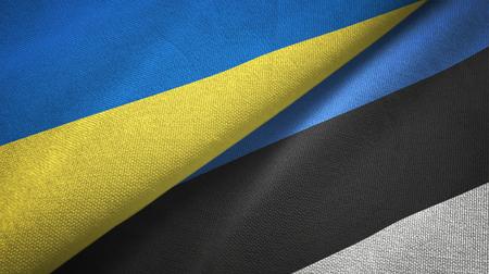 Ukraine and Estonia flags together textile cloth, fabric texture