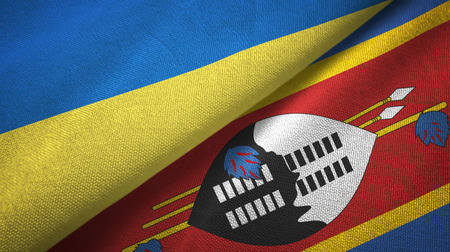 Ukraine and Eswatini Swaziland two folded flags together Imagens