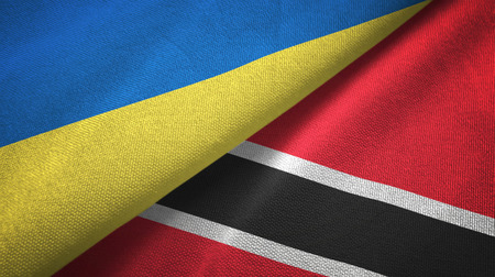 Ukraine and Trinidad and Tobago two folded flags together Stock Photo