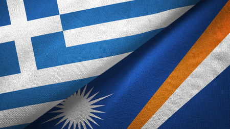 Greece and Marshall Islands two folded flags together Stock Photo