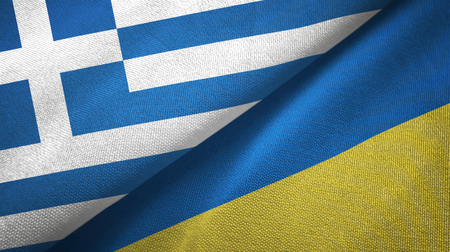 Greece and Ukraine flags together textile cloth, fabric texture