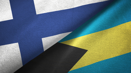 Finland and Bahamas two folded flags together Stock Photo