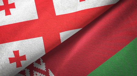 Georgia and Belarus flags together textile cloth, fabric texture Stock Photo