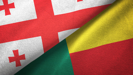 Georgia and Benin two folded flags together Stock Photo