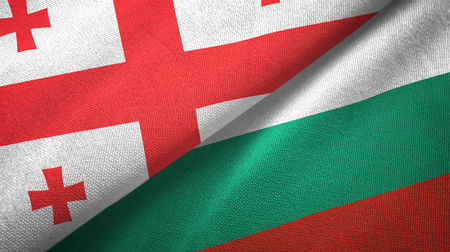 Georgia and Bulgaria flags together textile cloth, fabric texture Stock Photo