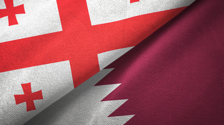 Georgia and Qatar flags together textile cloth, fabric texture Stock Photo