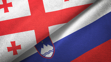 Georgia and Slovenia flags together textile cloth, fabric texture
