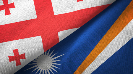 Georgia and Marshall Islands two folded flags together