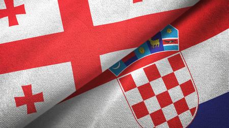 Georgia and Croatia flags together textile cloth, fabric texture Standard-Bild