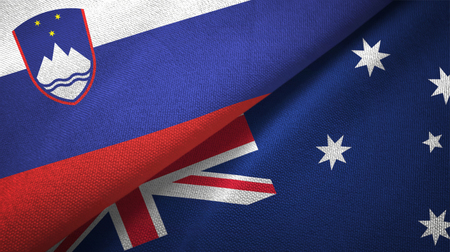 Slovenia and Australia flags together textile cloth, fabric texture Stock Photo - 121375319