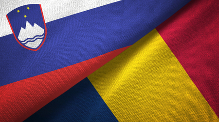 Slovenia and Chad two folded flags together Stock Photo