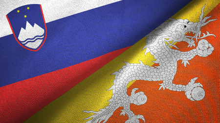 Slovenia and Bhutan two folded flags together Stok Fotoğraf