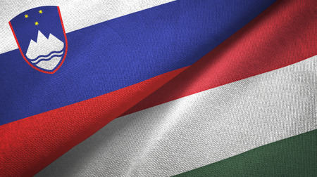Slovenia and Hungary flags together textile cloth, fabric texture