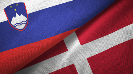 Slovenia and Denmark flags together textile cloth, fabric texture Stock Photo - 121375136