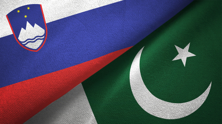 Slovenia and Pakistan flags together textile cloth, fabric texture Stock Photo