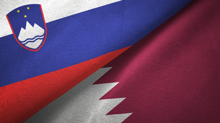 Slovenia and Qatar flags together textile cloth, fabric texture Stock Photo - 121374853