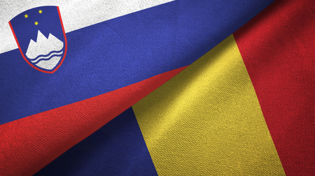 Slovenia and Romania flags together textile cloth, fabric texture