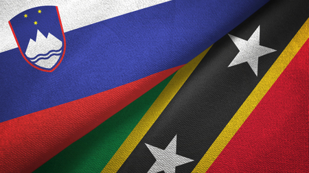 Slovenia and Saint Kitts and Nevis two folded flags together Stock Photo - 121374590