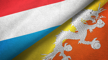 Luxembourg and Bhutan two folded flags together