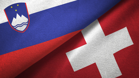 Slovenia and Switzerland flags together textile cloth, fabric texture Stok Fotoğraf