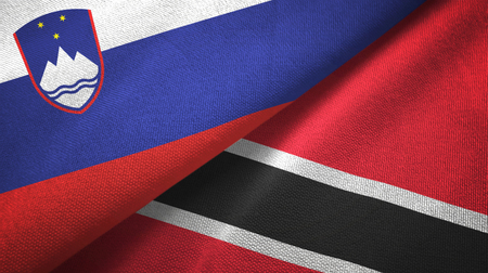 Slovenia and Trinidad and Tobago two folded flags together Stock Photo - 121374416