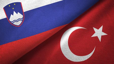 Slovenia and Turkey flags together textile cloth, fabric texture