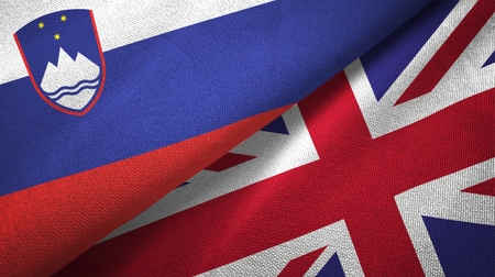 Slovenia and United Kingdom flags together textile cloth, fabric texture Stock Photo