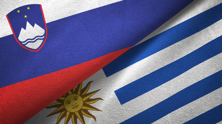 Slovenia and Uruguay two folded flags together Stock Photo
