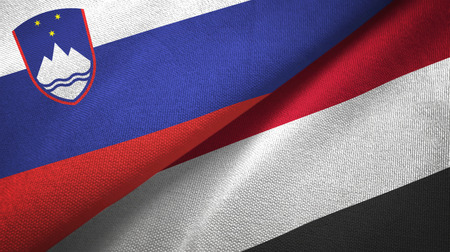 Slovenia and Yemen two folded flags together