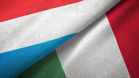 Luxembourg and Italy flags together textile cloth, fabric texture Stock Photo